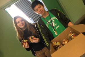 Student volunteers during fruit salad fundraiser