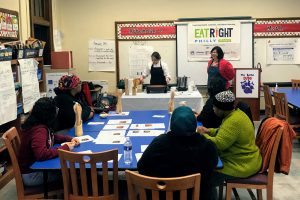 Caregivers participating in cooking class