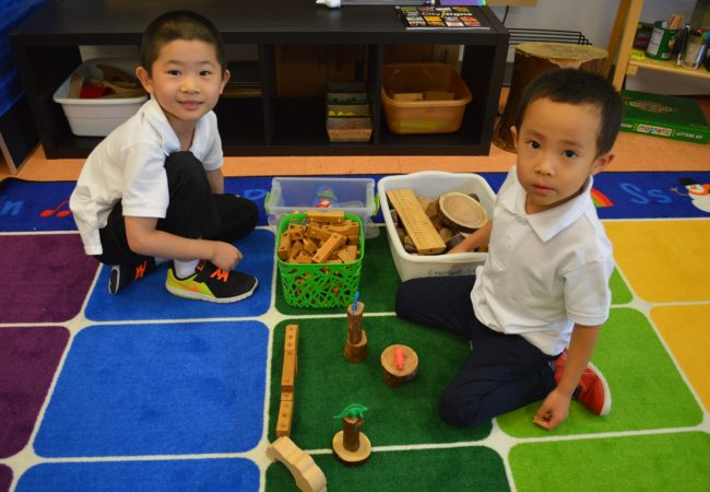 Kindergarten students working in classrooms