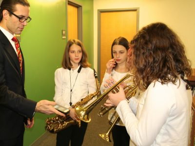 Music teacher preparing to perform with students