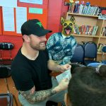 Teacher taking pictures with Eagles defender Chris Long